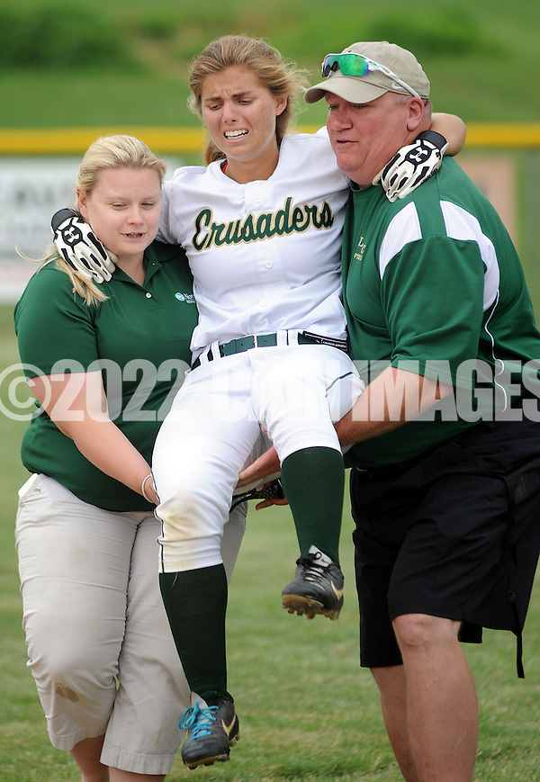 LYONS, PA - JUNE 09: Lansdale Catholic's Kristin Szczepaniak (C) is carried off the field by Silvia Sokol (L) and assistant coach Frank Rose (R) in the late in the game during the PIAA Class AAA softball semifinal June 9, 2014 Lyons, Pennsylvania. Bethlehem won 4-1. (Photo by William Thomas Cain/Cain Images) (William Thomas Cain)
