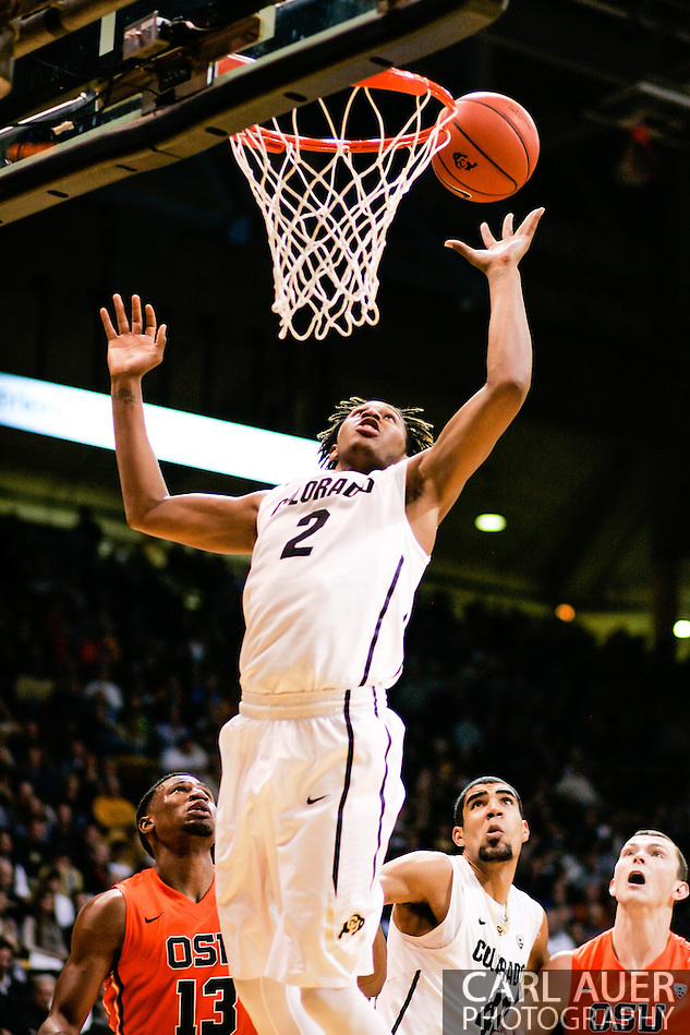 January 2nd, 2014:  Colorado Buffaloes sophomore forward Xavier Johnson (2) elevates for a rebound dunk in the second half of the NCAA Basketball game between the Oregon State Beavers and the University of Colorado Buffaloes at the Coors Events Center in Boulder, Colorado (Carl Auer/ZUMAPRESS.com)