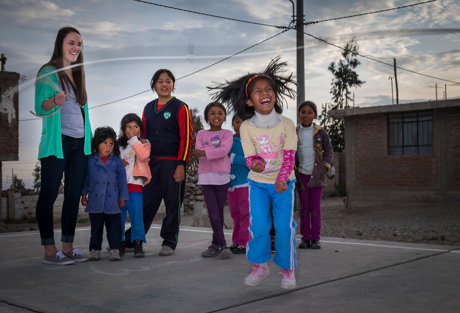 AREQUIPA, PERU - APRIL 4, 2014: Kids jumping rope and having fun with in the community of Flora Tristan with volunteers from HOOP Peru. HOOP Peru is a NGO fully committed to breaking the cycle of poverty by empowering the Flora Tristan families through enhancing their education. (Daniel Korzeniewski)