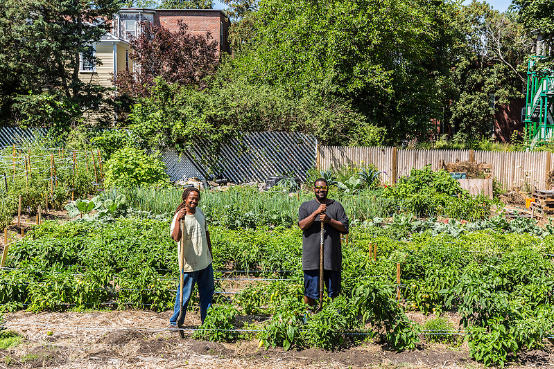 Bobby Walker and Chris Mables of the Urhan Farming Institute of Boston work at the Garrison-Trotter Farm in the Dorchester neighborhood of Boston, Massachusetts. (Jerry and Marcy Monkman)