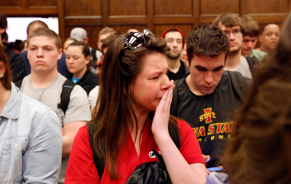 An Iowa State University student weeps alongside fellow students upon the announcement of the suspension of VEISHEA Wednesday on the campus of Iowa State Univerity in Ames.  Moments later, the distraught student left the packed Memorial Union room before president Leath finished his remarks. (Christopher Gannon/The Register)