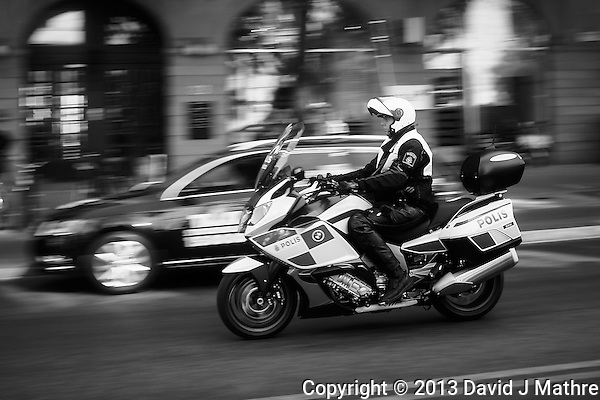 Motorcycle Patrol (Stockholm Polis). Image taken with a Leica X2 camera (ISO 100, 24 mm, f/4.5, 1/100 sec). In camera conversion to B&W. Semester at Sea Spring 2013 Enrichment Voyage. (David J Mathre)