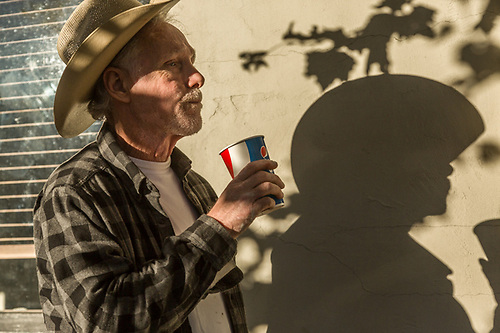 Profesional painter David Serta takes a break at the end of the day in downtown Calistoga. (Clark James Mishler)