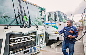 "Diesel mechanic Lawrence Henderson attaches a CNG-powered (compressed natural gas) Mack Truck to a time-fill station at Waste Pro, March 19, 2016, in Jacksonville, Florida. Waste Pro offers waste and recycling services to more than two million residential customers and more than 40,000 businesses in Alabama, Florida, Georgia, South and North Carolina, Louisiana, Mississippi, and Tennessee. The company has committed to ""going green"" by implementing a number of green initiatives, including using CNG (Clean Natural Gas) in its trucks, recycling more waste instead of sending it to landfills, and powering its regional headquarters throuh solar energy. (Photo by Carmen K. Sisson/Cloudybright) (Carmen K. Sisson/Cloudybright)"