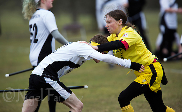 08 MAR 2015 - NOTTINGHAM, GBR - Snitch runner Nicole Stone (right) attempts to prevent Jimmy Boyd, a Leicester Thestrals' seeker, from seizing the snitch, a tennis ball in a black sock hanging from the back of her shorts, during the 2015 British Quidditch Cup at Woollaton Hall and Deer Park in Nottingham, Great Britain (PHOTO COPYRIGHT © 2015 NIGEL FARROW, ALL RIGHTS RESERVED) (NIGEL FARROW/COPYRIGHT © 2015 NIGEL FARROW : www.nigelfarrow.com)