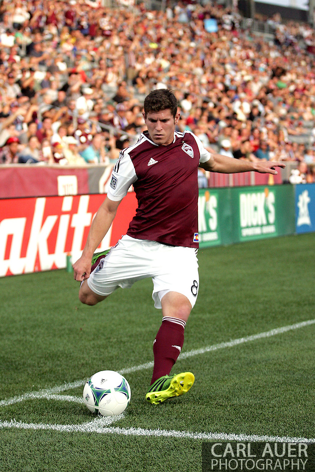 July 7th, 2013 - Colorado Rapids midfielder Dillon Powers (8) takes a corner kick attempt in the first half of action in the Major League Soccer match between D.C. United and the Colorado Rapids at Dick's Sporting Goods Park in Commerce City, CO (Carl Auer/Newsport)