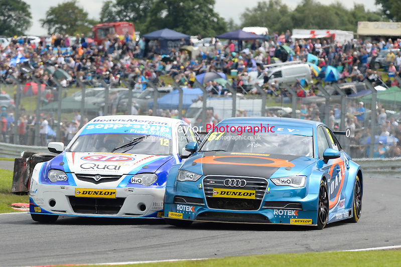#12 Dan Welch (GBR) - STP Racing with Sopp & Sopp Proton Gen-2 and #67 Robb Holland (USA) in the #67 Rotek Racing Audi S3 Saloon during the second BTCC race at Oulton Park, Little Budworth, Cheshire, United Kingdom. June 08 2014. World Copyright Peter Taylor/PSP. Copy of publication required for printed pictures.  Every used picture is fee-liable. http://archive.petertaylor-photographic.co.uk (Peter Taylor/PSP)