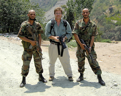 Paul Jeffrey (center) on assignment in Pakistan, with government-provided special forces soldiers who served as bodyguards.