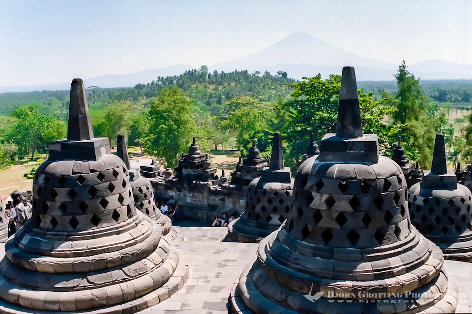 Java, Central Java, Borobodur. Borobudur is a 9th-century Buddhist monument near Magelang, Central Java. Stupas with the mount Merapi volcano in the background. (Photo Bjorn Grotting)