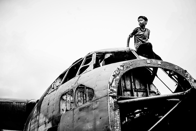 Remnants of the Vietnam war, known as the American War here, are on display and mix with youth from generations separated from warfare, yet still here to keep in their memories, in Phuoc Long, Binh Phuoc Province, southern Vietnam. (Quinn Ryan Mattingly)