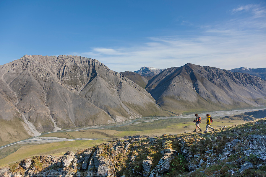 Hikers in the mountains bordering the Marsh Fork of the Canning River in the Arctic National Wildlife Refuge, Brooks Range mountains, Alaska. (Patrick J Endres / AlaskaPhotoGraphics.com)
