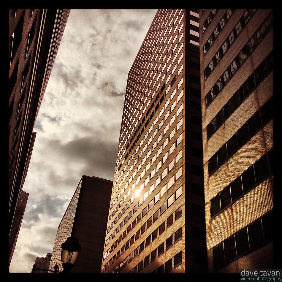 A tiny bit of sun reflects off a building on 18th Street in Center City Philadelphia on a mostly cloudy day, January 17, 2013. (Dave Tavani)