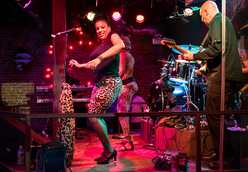 NEW ORLEANS - CIRCA FEBRUARY 2014: African American singer performing and dancing in a nightclub during the Mardi Gras celebration in the French Quarter in New Orleans (Daniel Korzeniewski)