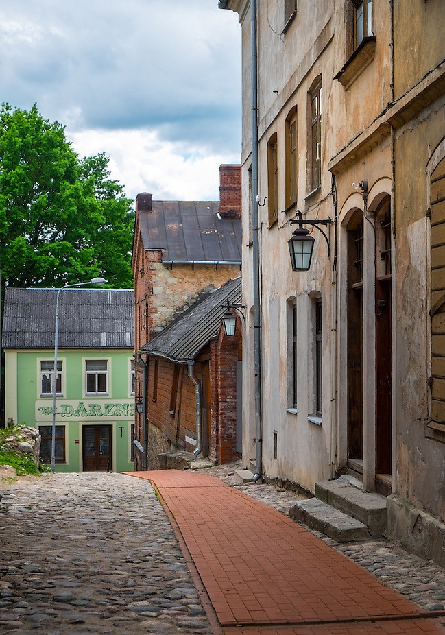 LATVIA, CESIS - CIRCA JUNE 2014: View of  typical cobblestone street in Cesis (Daniel Korzeniewski)