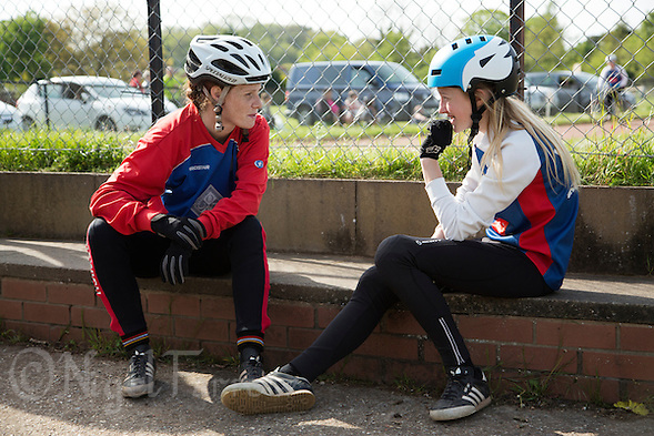 10 MAY 2015 - GREAT BLAKENHAM, GBR - 2012 European and British champion Lauren Jacobs (left) of Ipswich Eagles Cycle Speedway Club offers advice to team mate Chloe Pearce during the South East 2 League fixture against Great Blakenham at Great Blakenham, Suffolk, Great Britain (PHOTO COPYRIGHT © 2015 NIGEL FARROW, ALL RIGHTS RESERVED) (NIGEL FARROW/COPYRIGHT © 2015 NIGEL FARROW : www.nigelfarrow.com)