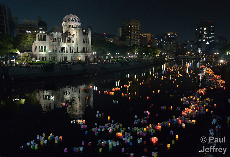 Floating candle lanterns fill a river on August 6, 2015, in Hiroshima, Japan, in front of the city's atomic bomb dome. The lanterns, thousands of which were launched on the 70th anniversary of the atomic bombing of the city, carry handmade messages and drawings, conveying each person's prayers for peace and comfort for the victims of the violence. (Paul Jeffrey)