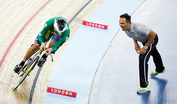 06 DEC 2014 - STRATFORD, LONDON, GBR - Gideoni Monteiro (BRA) (left) riding for Brazil receives advice from his coach during the men's Omnium 4km Individual Pursuit at the 2014 UCI Track Cycling World Cup  at the Lee Valley Velo Park. (PHOTO COPYRIGHT © 2014 NIGEL FARROW, ALL RIGHTS RESERVED) (NIGEL FARROW/COPYRIGHT © 2014 NIGEL FARROW : www.nigelfarrow.com)
