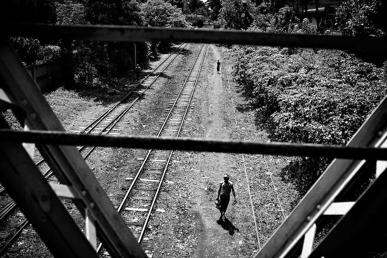 Men walk the railroad tracks in Yangon, Myanmar. (Quinn Ryan Mattingly)