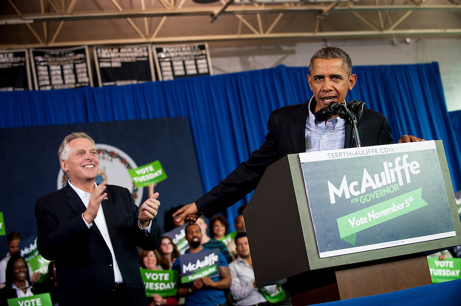 President Obama delivers remarks at a Terry McAuliffe campaign event at Washington-Lee High School, Arlington, Virginia, U.S., on Sunday, November 3, 2013. McAuliffe is the Democratic nominee in the 2013 Virginia gubernatorial election. Photographer: Pete Marovich/Bloomberg (Pete Marovich/Bloomberg)
