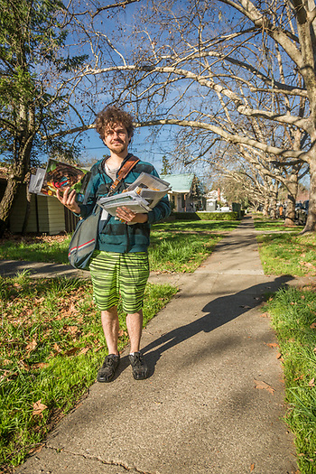 """I haven't yet received my uniform allowance.""  -One month resident of Calistoga and new mail carrier Julian Carson delivers mail on Cedar Street. (Clark James Mishler)"