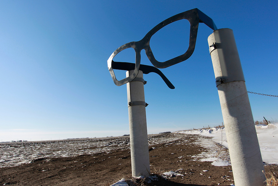 1/19/12 2:50:13 PM -- Clear Lake, IA, U.S.A. -- THIS IS FOR A LIFE COVER:.A giant pair of horn-rimmed glasses stand as a salute of Buddy Holly and mark the entrance to the crash site   a few miles outside of Clear Lake, Iowa..On Feb. 3, 1959, Buddy Holly, Ritchie Valens and the Big Bopper died when their plane crashed in a farm field north of Clear Lake, Iowa ? an event memorialized as ?the day the music died? in the 1971 song American Pie by Don McLean. The three 1950s stars played their last gigs at Clear Lake?s Surf Ballroom, which is intact today and holds an annual celebration of its moment in music history. The ballroom, largely the same as it was in its ?50s heyday, struggled as a for-profit business and has been operated as a non-profit since 2008. It hosts concerts, weddings, reunions and school tours. It has a small museum, but the big draw is the place itself. The maple dance floor and booths are original. One of the two original coat checks is still there and so is the phone that Holly used to call his wife before the fatal crash, the website boasts. The fun part is the annual gathering of fans from all over the world, which this year is Feb. 1-4 and is delicately called the ?winter dance party.? There are concerts each night, a bus outing to the crash site, which is marked by a giant pair of the glasses Holly wore, dance lessons, video and art contests and a gathering of the British Buddy Holly Society (whose members have been coming to Clear Lake for 23 years). Chuck Berry is a featured performer this year. It?s a charming and weird slice of Iowa life and rock ?n? roll history. -- ...Photo by Christopher Gannon for USA TODAY. (Christopher Gannon/for USA TODAY)