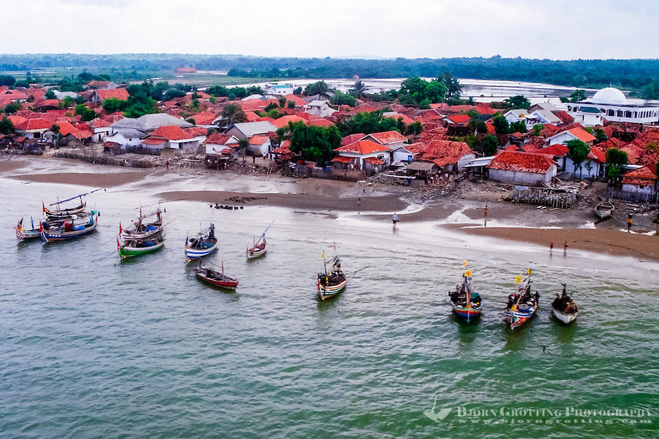 Java, East Java, Madura. Small village in the Sampang regency on south Madura with traditional vessels (from helicopter) (Photo Bjorn Grotting)
