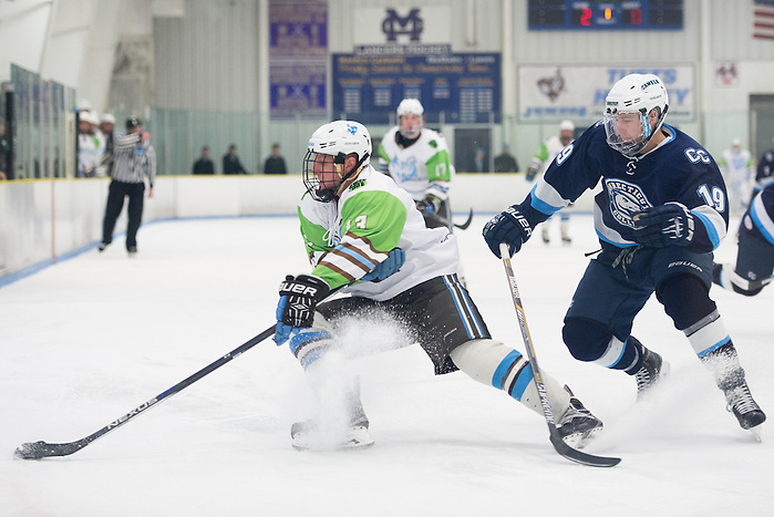 2/5/16 – Medford/Somerville, MA – Fighting a Hamilton defenseman, Tufts forward Matt Pugh, A17, rapidly changes direction with the puck in the game against Conn. College on Friday, Feb. 5, 2016. (Evan Sayles / The Tufts Daily) (Evan Sayles / The Tufts Daily)