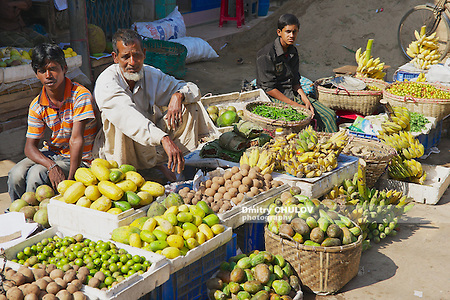 BANDARBAN, BANGLADESH - FEBRUARY 20, 2014: Unidentified men sell fruits at the local market in Bandarban, Bangladesh. The most remoted and least populated in the country Bandarban area became one of the most exotic tourist destination of Bangladesh after insurgency in the region had been ceased. (Dmitry Chulov)