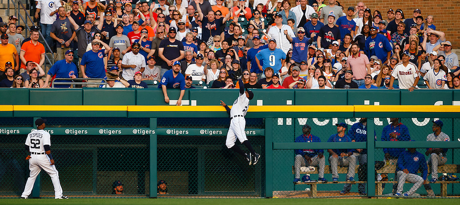Jun 9, 2015; Detroit, MI, USA; Detroit Tigers center fielder Rajai Davis (20) leaps up onto the wall to makes a catch of a ball hit batting Chicago Cubs catcher David Ross (3) in the second inning at Comerica Park. Mandatory Credit: Rick Osentoski-USA TODAY Sports (Rick Osentoski/Rick Osentoski-USA TODAY Sports)