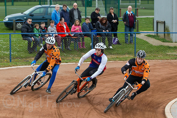 19 APR 2015 - IPSWICH, GBR - Josh Brooke (centre) of Ipswich Eagles races Damian Zareba (left) and Mikey Hewitson (right) of Sheffield Stars into the first corner during the two teams Elite League cycle speedway fixture at Whitton Sports and Community Centre in Ipswich, Suffolk, Great Britain (PHOTO COPYRIGHT © 2015 NIGEL FARROW, ALL RIGHTS RESERVED) (NIGEL FARROW/COPYRIGHT © 2015 NIGEL FARROW : www.nigelfarrow.com)