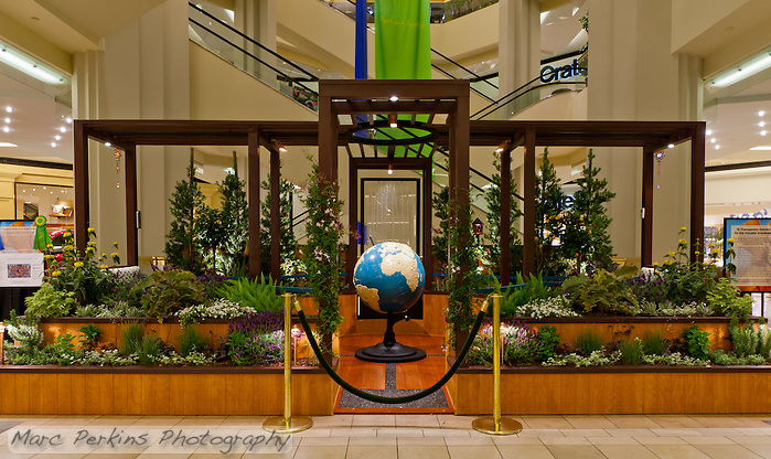 "A head-on view of Orange Coast College's Ornamental Horticulture Club's first-place winning garden installation at the 2012 South Coast Plaza Spring Garden Show in Costa Mesa, CA.  The theme for the show was ""healing gardens"", and the OCC team installed a ""garden for the visually impaired.""  The garden's centerpiece is a 1957 restored globe for the blind, with the world geography in exaggerated height to be sensed by the touch of blind people; the locations of plants in the garden was indicated in braille on the globe.  This picture was taken Thursday April 27, 2012 at ~9pm, less than 48 hours after my in-progress pictures. (Marc C. Perkins)"