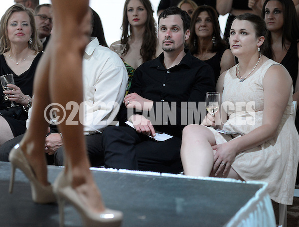 DOYLESTOWN, PA - JUNE 06: Matthew Carroll (2nd from right) and Nicole Hatch (R) watch a model on the runway during the Canines on the Catwalk fashion show June 6, 2014 at the Michener Museum in Doylestown, Pennsylvania. Canines on the Catwalk is a fashion show coupling professional models, high-end clothes and dogs. The program benefits animal rescue  (Photo by William Thomas Cain/Cain Images) (William Thomas Cain)