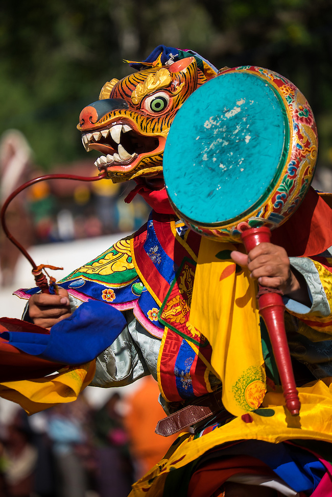 WANGDUE PHODRANG, BHUTAN - CIRCA OCTOBER 2014: Mask performer dancing during the Tshechu Festival inl Bhutan (Daniel Korzeniewski)