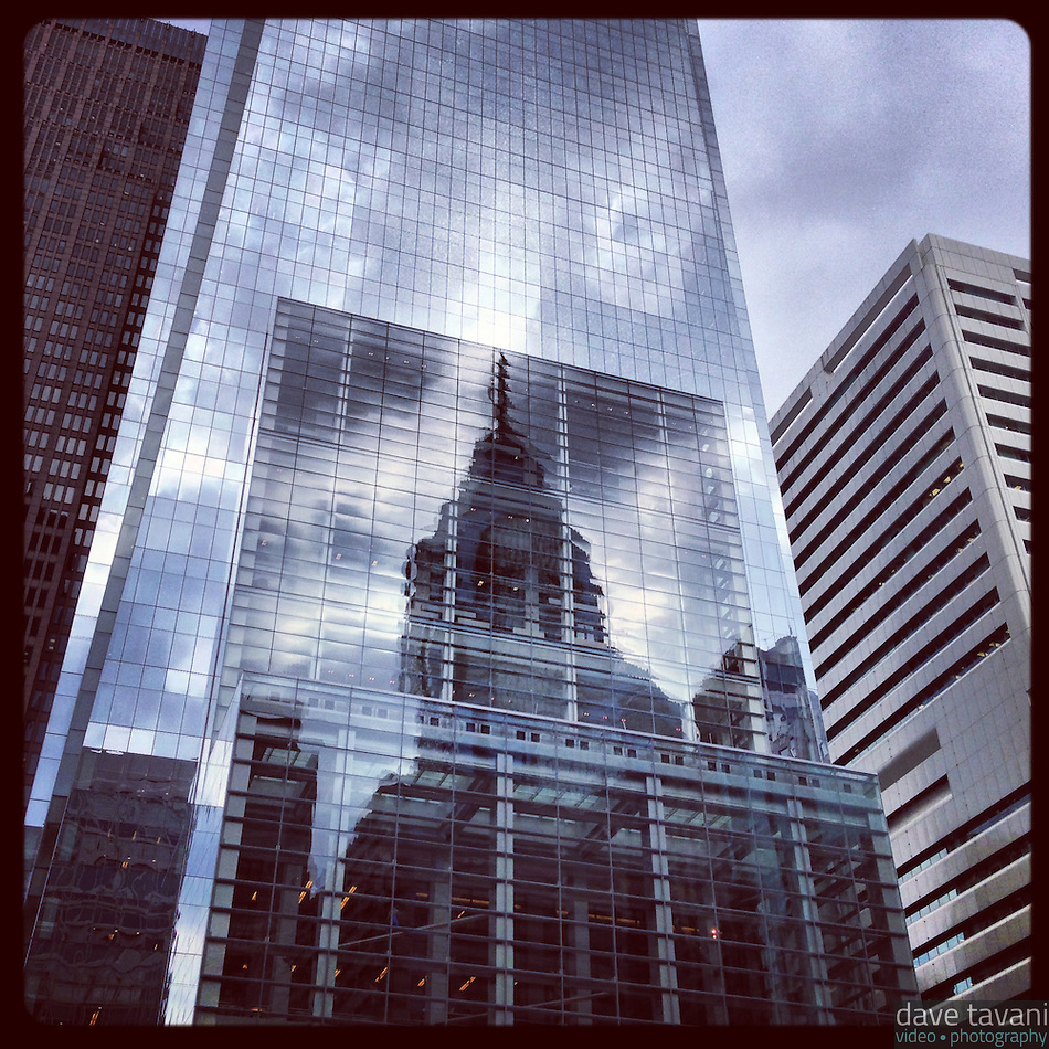 Liberty One reflects in the Comcast Center on a mostly cloudy day in Center City Philadelphia, January 17, 2013. (Dave Tavani)