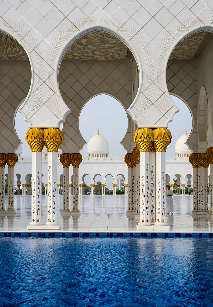 UNITED ARAB EMIRATES, ABU DHABI - CIRCA JANUARY 2017: Pool, arches and columns of the Sheikh Zayed Mosque (Daniel Korzeniewski)