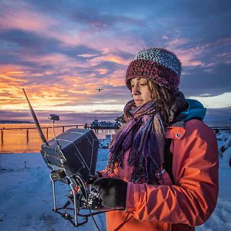 Hailey Driver of Sky Picture Films operates a remote camera suspended below a remote control helicopter at the small boat launch near Ship Creek, Anchorage        h.driver907@gmail.com (Clark James Mishler)