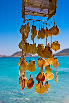 Dangling shells in a wind chime overlooking the water at a beach in Mykonos Greece (Ian C Whitworth)