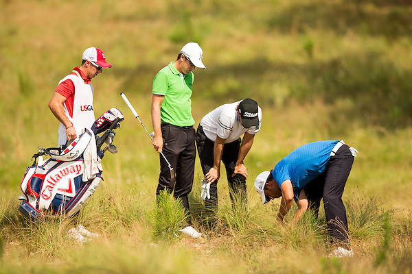 Pablo Larrazabal, right, along with his caddie, Chris Rice, Erik Compton and Scott Langley look for his ball on the 13th hole during the second round of the 2014 U.S. Open at Pinehurst Resort & C.C. in Village of Pinehurst, N.C. on Friday, June 13, 2014.  (Copyright USGA/Darren Carroll) (Darren Carroll/USGA Museum)