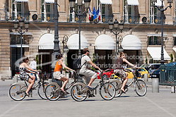 tourists on hired bikes in Place Vendôme Paris France in May 2008 (Christopher Holt LTD - LondonUK, Christopher Holt LTD/Image by Christopher Holt - www.christopherholt.com)