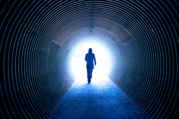 A woman walks 'into the light - at the end of the tunnel' (Douglas Page)