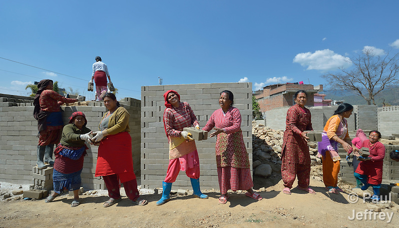 Women stack blocks in Sanogoan, Nepal, that they and their neighbors will use to build new homes. This Newar community was hard hit by the April 2015 earthquake that ravaged Nepal, losing almost all their housing, but they've been helped by the ACT Alliance to rebuild their lives. The ACT Alliance has provided blankets, tents, and livelihood assistance, and is helping villagers form the tens of thousands of cement blocks they will need to construct permanent housing. (Paul Jeffrey)