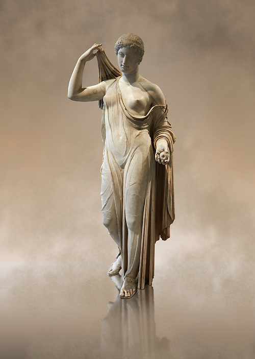 """Aphrodite of Fréjus in the style known as """"Venus Genetrix"""". A 1.64m high Roman statue, dating from the end of the 1st century BC to the start of the 1st century AD, in Parian marble, was discovered at Fréjus (Forum Julii) in 1650. It is considered as the best Roman copy of the lost Greek work. Louvre Museum, Paris The Venus Genetrix style of statue depicts Aphrodite (Venus to the Romans) as Genetrix ( Latin for Mother). This sculptural type was adopted by the Julia-Claudian dynasty after Julius Caesar claimed that he was defended from Venus herself.  The original lost Greek statue is attributed to Greek sculpture Callimachus who created a Bronze Aphrodite in 420-410. According to Pliny's Natural History showing her dressed in a light but clinging chiton or peplos, which was lowered on the left shoulder to reveal her left breast and hung down in a sheer face and decoratively carved so as not to hide the outlines of the woman's body. Venus was depicted holding the apple won in the Judgement of Paris in her left hand, whilst her right hand moved to cover her head. From the lost bronze original are derived all surviving copies. The composition was frontal, the body's form monumental, and in the surviving Roman replicas its proportions are close to the Polyclitean, an ancient Greek sculptor in bronze of the fifth century BC. (Paul E Williams)"""