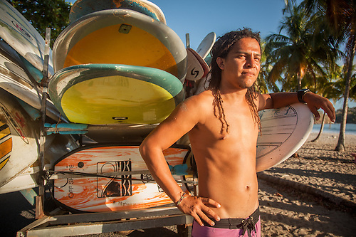 "Surfing instructor Nelson Juarez with ""Surf Chillasana"" at Playa Corilla, Costa  Rica, Central America (Clark James Mishler)"