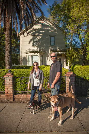 Wine educator Ilya Smock with her Estate manager husband, Richard Smock, and their two dogs in front of the Hideaway Cotteges on Fairway Street in Calistoga. (Clark James Mishler)