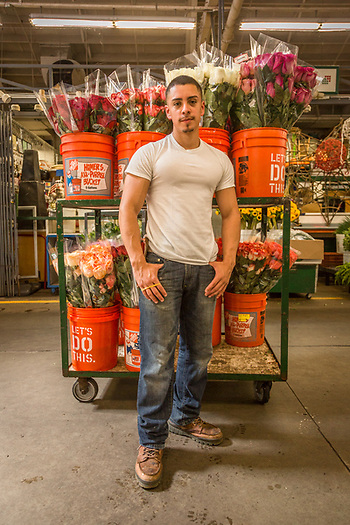 """I've been working here since I was 10.""  -Twenty year old business management student Mario Gonalez takes a break at his family's flower business at the San Francisco Flower Market. (Clark James Mishler)"