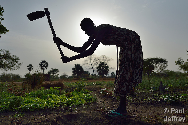 Martha Yar uses a hoe to prepare the ground for planting at the Multi Agricultural Jesuit Institute of Sudan (MAJIS), an agricultural school located outside Rumbek, South Sudan. (Paul Jeffrey)
