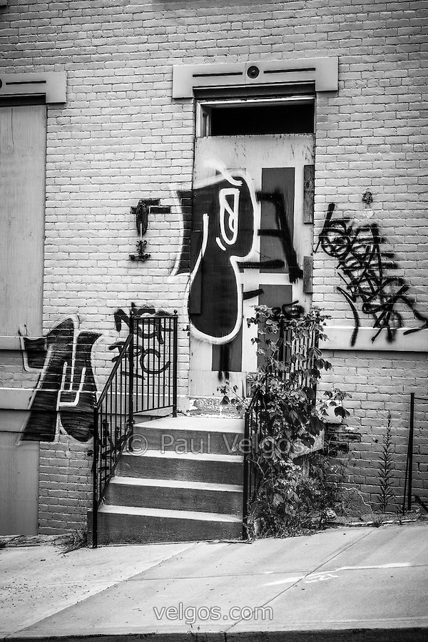 Picture of graffiti on Cincinnati abandoned buildings at the Glencoe-Auburn Place complex in Cincinnati Ohio. The Glencoe-Auburn Hotel and Glencoe-Auburn Place Row Houses were built in the late 1800's and are listed on the U.S. National Register of Historic Places. The complex is currently abandoned and in extremely poor condition. (Paul Velgos)