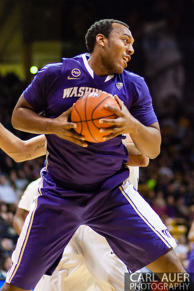 February 9th, 2014:  Washington Huskies senior forward Perris Blackwell (2) grabs a defensive rebound during the second half of the NCAA Basketball game between the Washington Huskies and the University of Colorado Buffaloes at the Coors Events Center in Boulder, Colorado (Carl Auer/ZUMAPRESS.com)