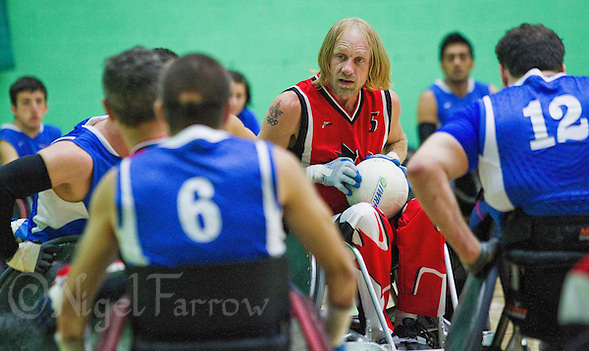 15 AUG 2011 - LEEDS, GBR - Canada's Garett Hickling prepares to pass during the wheelchair rugby exhibition match against Great Britain (PHOTO (C) NIGEL FARROW) (NIGEL FARROW/(C) 2011 NIGEL FARROW)