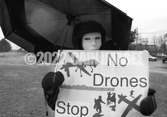 HORSHAM, PA - MARCH 29:  Karen Barton, along with members of Coalition for Peace Action protest the Horsham Drone Command Center to protest March 29, 2014 in Horsham, Pennsylvania. The mask represents civilians that have been killed by drone strikes. (Photo by William Thomas Cain/Cain Images) (William Thomas Cain)